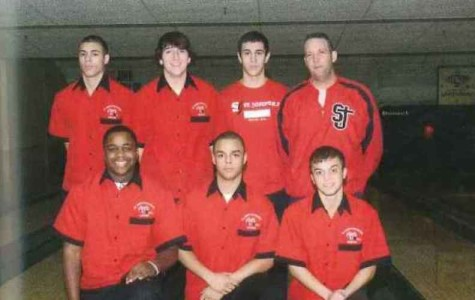 Coach Krasny, (top row, last on the right) pictured with the bowling team, including Brian Powers. (top row, second from the left)