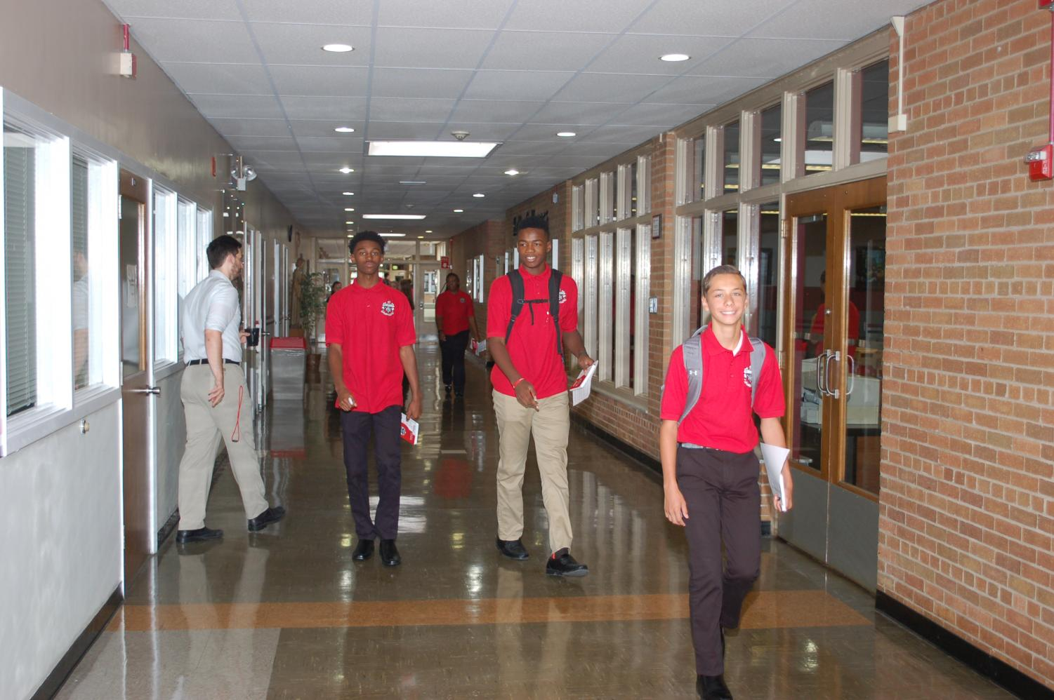Members of the Class of 2022 make their way into the building on the first day of school.