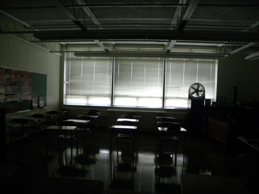 Curtains+are+drawn+and+the+lights+are+out+as+students+participate+in+an+active+shooter+drill.