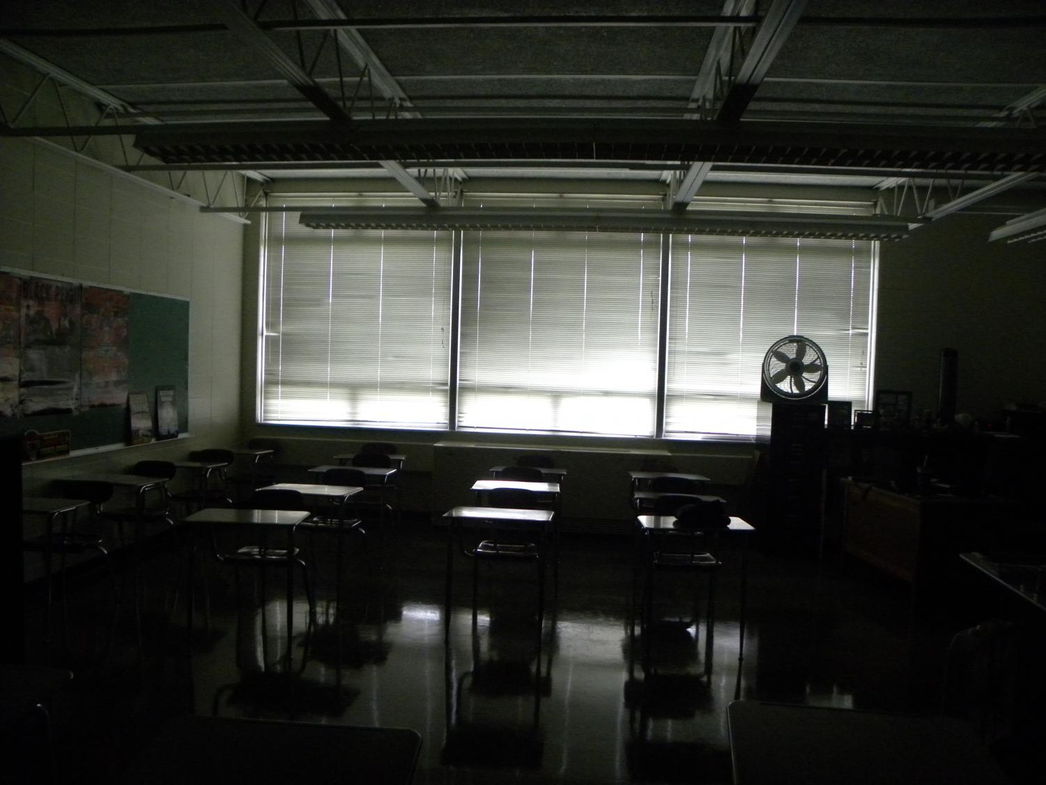 Curtains are drawn and the lights are out as students participate in an active shooter drill.